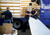 Removal men unloading a pantechnicon. Taking a break. - John Harris - 2000s,2004,a,belongings,box,boxes,break,carries,carry,carrying,coffee,domestic,ebf economy,goods,HAULAGE,HAULIER,HAULIERS,heavy,hgv,hgvs,home,homes,house,houses,housing,housing Market,job,jobs,lab lbr