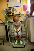 Patient aged 5 being weighed on scales prior to being examined by heart specialist to diagnose a heart murmur. Birmingham Children's Hospital. - John Harris - 08-07-2004