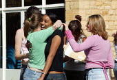 Pupils and their A level results, Shottery Grammar School for Girls, Stratford upon Avon. - John Harris - 2000s,2004,6th,6th form,adolescence,adolescent,adolescents,BAME,BAMEs,black,BME,bmes,CELEBRATE,celebrating,celebration,celebrations,child,CHILDHOOD,children,congratulating,congratulations,cultural,div