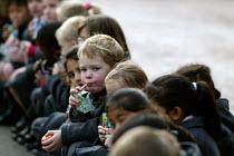 Junior pupils eating a packed lunch, drinking cartons of fruit juice, Birmingham. - John Harris - 2000s,2004,boy,boys,child,CHILDHOOD,children,cities,city,day out,diet,diets,drink,drinking,drinks,eating,edu,edu education,educate,educating,education,educational,food,FOODS,fruit,FRUITS,healthier,hea