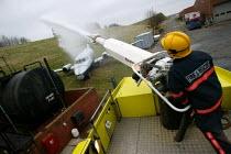Firefighting appliance extinguishing an aircraft fire on a training exercise. Airport Fire Service Birmingham International Airport - John Harris - 31-01-2005
