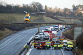 Emergency services at an accident which caused the M40 motorway to be closed in both directions. A helicopter air ambulance can be seen taking off. - John Harris - 18-02-2005