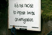 Conservative election poster on a billboard- It's not racist to limit immigration - Birmingham - John Harris - 2000s,2005,advertisement,advertisements,advertising,aerospace,Asylum Seeker,Asylum Seeker,BAME,BAMEs,bigotry,billboard,billboards,Birmingham,Black,BME,BME Black minority ethnic,bmes,campaign,campaigni