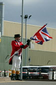 John Bull, who has kept a vigil outside the factory gates, furls his union jack and packs up as the company goes into receivership, MG Rover Group Longbridge Birmingham - John Harris - 08-04-2005