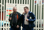 Workers leave MG Rover Group Longbridge Birmingham as the company goes into receivership. - John Harris - 08-04-2005