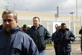 Workers leave MG Rover Group Longbridge, Birmingham as the company goes into receivership - John Harris - 08-04-2005