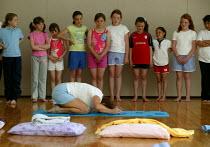 Alwynne Cartmell teaching yoga. Pupils exercising in a before school morning Yoga class, Mytham CP School, Bolton. - John Harris - 14-06-2005