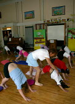 Alwynne Cartmell teaching yoga. Pupils exercising in a pre school morning Yoga class, Mytham CP School, Bolton. - John Harris - 14-06-2005