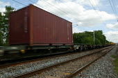 Freight train carriages on the main line. - John Harris - 2000s,2005,blur,cargo,container,containers,country,countryside,EBF Economy,ews,fast,freight,goods,infrastructure,line,miles,motion,movement,network,outdoors,outside,RAIL,railway,RAILWAYS,rural,speed,s