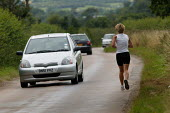 Jogger, Warwickshire. - John Harris - 2000s,2005,AUTO,AUTOMOBILE,AUTOMOBILES,AUTOMOTIVE,car,cardio,cardio vascular,cardiovascular,cars,country,countryside,exercise,exercises,exercising,FEMALE,fit,getting,highway,jog,jogger,joggers,jogging