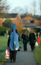 Pupils walking home from school. - John Harris - 2000s,2006,adolescence,adolescent,adolescents,boy,boys,child,CHILDHOOD,children,comprehensive,COMPREHENSIVES,edu education,footpath,footpaths,home,instrument,instruments,juvenile,juveniles,kid,kids,ma