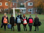 Pupils walking home from school. - John Harris - 2000s,2006,adolescence,adolescent,adolescents,bag,bags,carries,carry,carrying,child,CHILDHOOD,children,comprehensive,COMPREHENSIVES,edu education,female,females,footpath,footpaths,girl,girls,grammar s