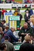 Bookmakers taking bets. Steeplechase racing at Stratford on Avon racecourse. - John Harris - 2000s,2006,accountant,accountants,accounting,animal,animals,bet,bets,betting,board,boards,bookie,bookies,bookmaker,bookmakers,capitalism,capitalist,cash,chance,course,courses,Domesticated Ungulates,eb