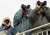 Racegoers watching the race through binoculars. Steeplechase racing at Stratford on Avon racecourse. - John Harris - ,2000s,2006,accountant,accountants,accounting,animal,animals,bet,bets,betting,board,boards,bookie,bookies,bookmaker,bookmakers,capitalism,capitalist,chance,course,courses,Domesticated Ungulates,ebf ec