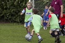 Primary school pupils playing football. - John Harris - 18-10-2006