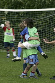 Primary school pupils playing football. Celebrating a goal - John Harris - 18-10-2006