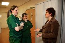 Union organiser talking to factory workers. - John Harris - 19-01-2007