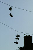 Shoes dangling from telephone wires, housing estate Nottingham. - John Harris - 2000s,2007,adolescence,adolescent,adolescents,anti social behavior,anti social behaviour,anti socialanti social behavior,antisocial,antisocial behaviour,boy,boys,bullies,bully,bullying,child,CHILDHOOD