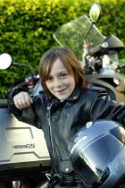 Small boy with motorcycle. - John Harris - 2000s,2007,bike,bikes,boy,boys,child,CHILDHOOD,children,emilio,EMOTION,EMOTIONAL,EMOTIONS,happiness,happy,helmet,HELMETS,jacket,juvenile,juveniles,kid,kids,leather,LFL Leisure,male,motorbike,MOTORBIKE