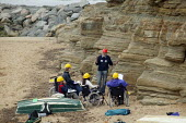 Geologist lecturer from Durham University lecturing on the Jurassic coastline to disabled Open University students during a field trip, Staithes, North Yorkshire. - John Harris - 21-07-2007