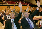 Tony Woodley, TGWU and Dereck Simpson Amicus now Unite, voting on an EU Constitution / Reform Treaty, TUC Conference 2007 - John Harris - .,2000s,2007,Amicus,conference,conferences,congress,Constitution,democracy,hands,member,member members,members,of,people,Reform,REFORMING,reforms,show,Trade Union,Trade Union,trade unions,Trades Union