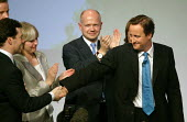 David Cameron shaking hands with George Osborne MP after addressing Conservative Party Conference Blackpool - John Harris - 2000s,2007,applauding,applause,Conference,conferences,CONSERVATIVE,conservatives,hands,mp,Party,pol politics,Standing ovation