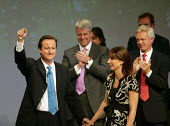 David Cameron and his wife Samantha after addressing Conservative Party Conference Blackpool - John Harris - ,2000s,2007,applauding,applause,Conference,conferences,CONSERVATIVE,conservatives,mp,Party,pol politics,Standing ovation