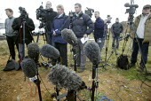 TV crews and microphones at press conference about the search for the firefighters who died in the fire at the Atherstone warehouse. Four firefighters are believed to have died tackling the blaze. Pac... - John Harris - 2000s,2007,adult,adults,Atherstone on stour,broadcast,broadcasting,camera,cameras,communicating,communication,conference,conferences,filming,fire,fire brigade,FIREFIGHTER,firefighters,fireman,firemen,