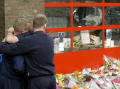 Firefighters comforting each other at Alcester Fire Station. Four firefighters died in the fire at the Atherstone warehouse. - John Harris - 08-11-2007