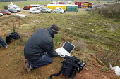 Photographer sending his pictures to a newspaper using a laptop and a mobile phone. Four firefighters are believed to have died tackling the blaze. Packhouse at Bomfords Ltd Atherstone Industrial Esta... - John Harris - 05-11-2007