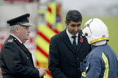 Sir Ken Knight Chief Fire and Rescue Adviser to the government, with Parmjit Dhanda MP talking to a senior officer. Four firefighters are believed to have died tackling the blaze. Packhouse at Bomford... - John Harris - 2000s,2007,adult,adults,and,asian,at,Atherstone on stour,black,BME Black minority ethnic,communicating,communication,Communities,conversation,death,deaths,Department,dia disaster disaster accident a,d