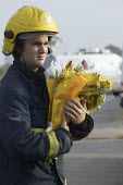 Firefighters from Bidford on Avon leaving flowers in memory of the firefighters who died in the fire at the Atherstone warehouse. Four firefighters are believed to have died tackling the blaze. Packho... - John Harris - 2000s,2007,adult,adults,at,Atherstone on stour,bunch of,death,deaths,dia disaster disaster accident a,died,emotion,emotional,EMOTIONS,fire,fire brigade,firefighter,firefighters,fireman,firemen,fires,F