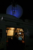 TV outside broadcast van editing and transmitting news. - John Harris - 06-11-2007
