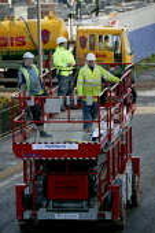 Building workers riding a Skyjack hydraulic Elevating Work Platform, Warwickshire - John Harris - 2000s,2008,brownfield,Building,building site,BUILDINGS,capitalism,capitalist,Construction Industry,developer,developers,development,EBF economy,elevating,Industries,industry,job,jobs,LAB LBR Work,make