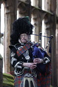 Scottish piper playing - 50 per cent of pipers suffer from RSI and hearing problems. Hundreds of firefighters attended a memorial service to remember four of their colleagues killed in a warehouse bla... - John Harris - 25-01-2008