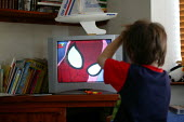 Young boy watching Spider man on television at home - John Harris - 25-07-2004