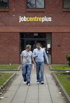 Young men leaving Jobcentre Plus in West Bromwich. - John Harris - 20-02-2008