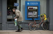 An elderly man at a building society branch in the High Street. - John Harris - ,2000s,2008,account,adult,adults,age,ageing population,bicycle,bicycles,BICYCLING,Bicyclist,Bicyclists,BIKE,BIKES,building,building society,BUILDINGS,Cash Machine,coventry,CYCLE,cycles,CYCLING,Cyclist