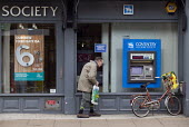 An elderly man at a building society branch in the High Street. - John Harris - 2000s,2008,account,adult,adults,age,ageing population,bicycle,bicycles,BICYCLING,Bicyclist,Bicyclists,BIKE,BIKES,building,building society,BUILDINGS,Cash Machine,coventry,CYCLE,cycles,CYCLING,Cyclist,