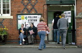 Voters at a polling station. Wellesbourne, Warwickshire. - John Harris - 2000s,2008,council,Council Services,Council Services,democracy,election,elections,FEMALE,hall,local,local authority,male,man,men,people,person,persons,pol politics,political,POLITICIAN,POLITICIANS,pol