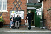 Voters at a polling station. Wellesbourne, Warwickshire. - John Harris - 2000s,2008,council,democracy,election,elections,FEMALE,hall,local,local authority,male,man,men,people,person,persons,pol politics,political,POLITICIAN,POLITICIANS,politics,polling,rural,station,STATIO