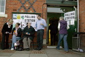 Voters at a polling station. Wellesbourne, Warwickshire. - John Harris - ,2000s,2008,council,democracy,election,elections,FEMALE,hall,local,local authority,male,man,men,people,person,persons,pol politics,political,POLITICIAN,POLITICIANS,politics,polling,rural,station,STATI