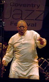 Hugh Masekela, South African Jazz musician and Anti Aparthid campaigner playing, Coventry Jazz Festival - John Harris - 2000s,2008,ACE,ace culture,african,africans,Afrobeat,BAME,BAMEs,black,BME,bmes,brass,dance,dancer,dancers,dancing,diversity,ethnicity,Festival,FESTIVALS,flugelhorn,Hugh,instrument,instruments,Jazz,Mas