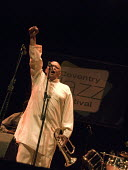 Hugh Masekela, South African Jazz musician and Anti Aparthid campaigner playing, Coventry Jazz Festival - John Harris - 2000s,2008,AAM,ACE,ace culture,African,africans,Afrobeat,anti apartheid movement,BAME,BAMEs,black,BME,bmes,brass,clenched fist,diversity,ethnicity,Festival,FESTIVALS,flugelhorn,Hugh,instrument,instrum