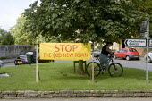 Banner in protest at the proposed new Middle Quinton eco town Mickleton village green, Gloucestershire. - John Harris - 29-07-2008