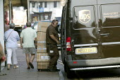 Delivery by UPS van in the high street delivering to a shop. - John Harris - 24-07-2008