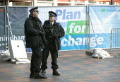 Armed police officers guarding the Conservative Party Conference 2008 Birmingham. - John Harris - 2000s,2008,53,adult,adults,armed,automatic,Carbine,cities,city,CLJ,Conference,conferences,conservative,Conservative Party,conservatives,counter terrorism,firearm,firearms,guarding,gun,guns,Heckler &,K