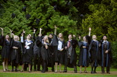 Graduates celebrate their degree passes by the traditional throwing of the mortar boards in the air. Graduation Day, Oxford Brookes University - John Harris - 05-09-2008