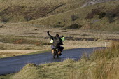 Youth riding a mini motorbike without a helmet, in the hills above Merthyr Tydfil - John Harris - 10-12-2008