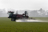 Crop spraying on a farm in Leicestershire. - John Harris - 2000s,2009,agricultural,agriculture,agrochemicals,capitalism,capitalist,cereal crop,chemical,chemicals,country,countryside,crop,crops,driver,drivers,driving,EBF,Economic,Economy,employee,employees,Emp